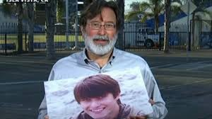 Richard Martinez holds a picture of his son, who was killed by a gunman over the weekend.