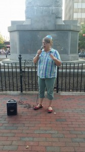 Me, speaking at last night's Bitter Pill rally. We all wore these silly pillbox hats, but we are very serious about protecting women's rights.