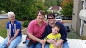 My friends Jan and Angie Buchanan and their son, Jasper, with Rev. Dorri Sherill