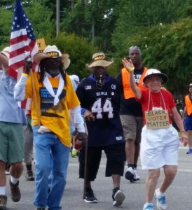 "Middle Passage and ""Granny"" Ruth Zalph walking along Highway 401 in North Carolina during the NAACP's Journey for Justice last year. We are called to stand up for justice, we are called to love one another, now more than ever."