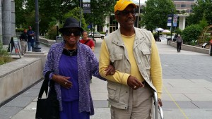 Ms. Rosanell Eaton arrives at a Moral Monday event with Charles Cook.
