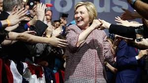 Hillary in her Armani jacket, which was criticized for being too expensive. Photo from CNBC